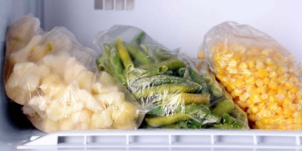 3 Plastic Bags in Freezer with Cauliflower, Green Beans and Corn