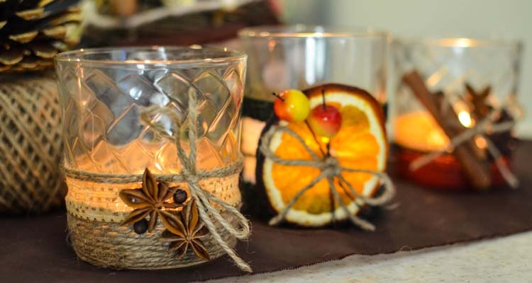 Candles Decorated with Twine, Anise Stars, Citrus Slices and Cinnamon Sticks