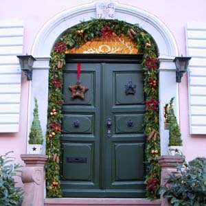 Entrance, Doorway Decorated for Christmas with Garland, Living Trees and Wreath