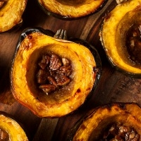 Acorn squash baked with butter, brown sugar and pecans.