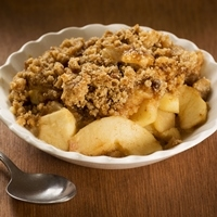 Apple crisp with oatmeal and brown sugar topping.