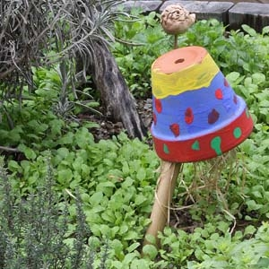 Herb Garden with Garden Art, Child's Painted Pot