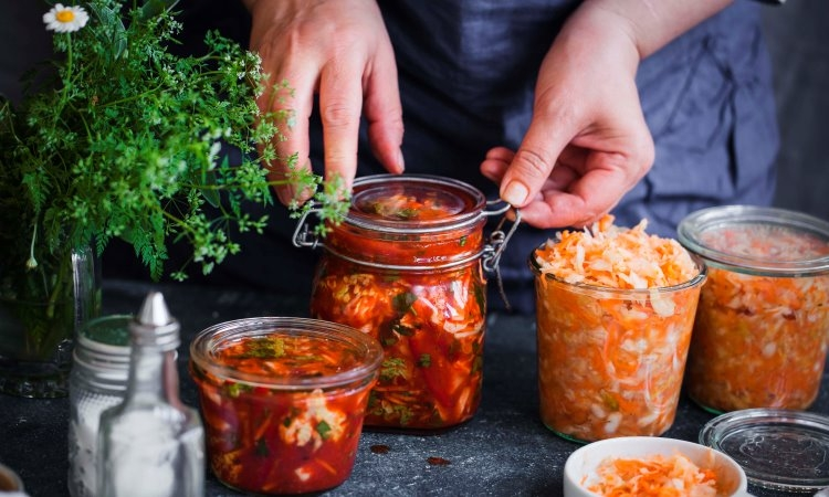 covering jars of fermenting vegetables with lids or weights