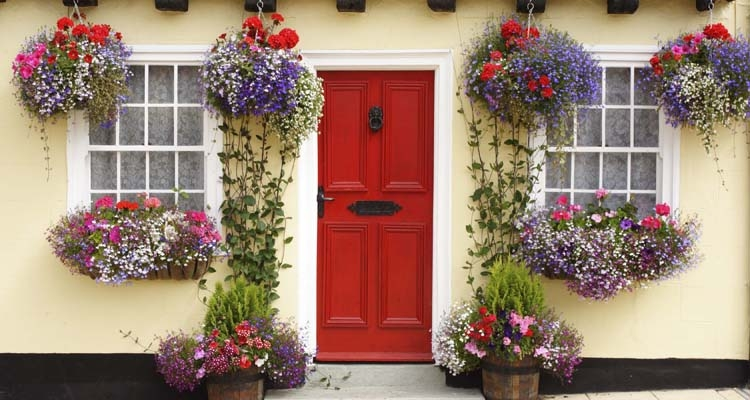 Hanging Baskets, Window Boxes, Planters Loaded with Flowers near Red Front Door