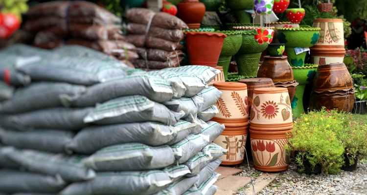 Bags of soil and containers in garden center