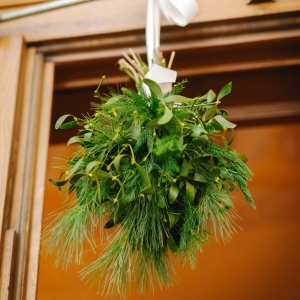 hanging ball made from mistletoe and evergreen tree branches
